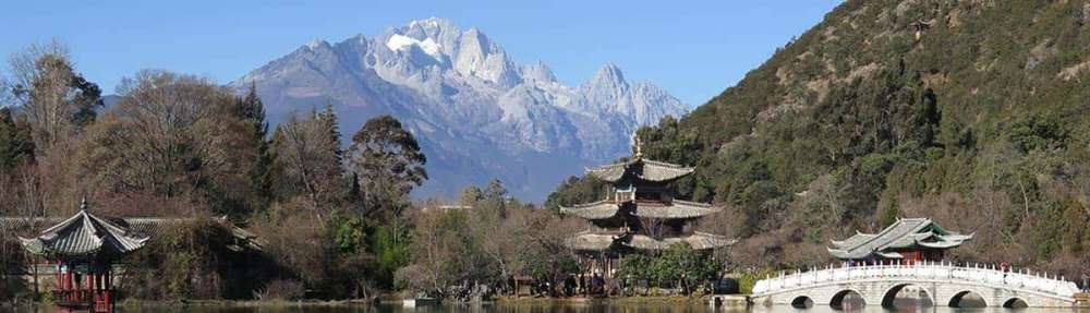 Overlooking old Chinese temples with mountains in the background